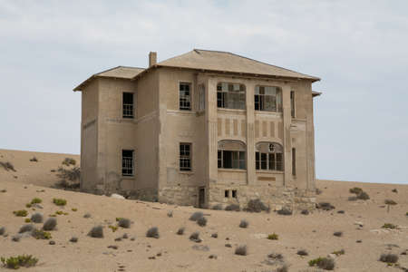 NAMIBIA, KOLMANSKOP - SEPTEMBER, 14. 2014: Ghost Town Kolmanskop, former Diamond Dagger Town in desert stripe near Luederitz. It was used from 1908 till 1930. Now its abandoned and desertificated. Quartiermeister