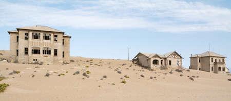 kolmanskop: NAMIBIA, KOLMANSKOP - SEPTEMBER, 14. 2014: Ghost Town Kolmanskop, former Diamond Dagger Town in desert stripe near Luederitz. It was used from 1908 till 1930. Now its abandoned and desertificated.
