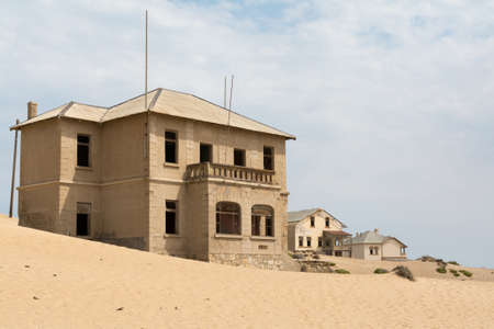 vanished: NAMIBIA, KOLMANSKOP - SEPTEMBER, 14. 2014: Ghost Town Kolmanskop, former Diamond Dagger Town in desert stripe near Luederitz. It was used from 1908 till 1930. Now its abandoned and desertificated. Architect Building. Editorial
