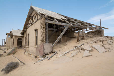 NAMIBIA, KOLMANSKOP - SEPTEMBER, 14. 2014: Ghost Town Kolmanskop, former Diamond Dagger Town in desert stripe near Luederitz. It was used from 1908 till 1930. Now its abandoned and desertificated.