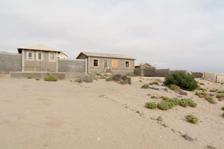 vanish: NAMIBIA, KOLMANSKOP - SEPTEMBER, 14. 2014: Ghost Town Kolmanskop, former Diamond Dagger Town in desert stripe near Luederitz. It was used from 1908 till 1930. Now its abandoned and desertificated.