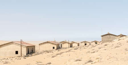 NAMIBIA, KOLMANSKOP - SEPTEMBER, 14. 2014: Ghost Town Kolmanskop, former Diamond Dagger Town in desert stripe near Luederitz. It was used from 1908 till 1930. Now its abandoned and desertificated. Worker Barracks.