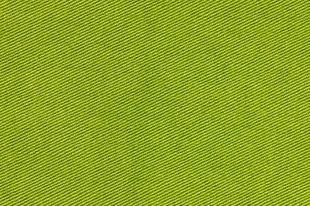 Gedetailleerde Close-Up van een groen gekleurd stoffenpatroon voor achtergronddoeleinden