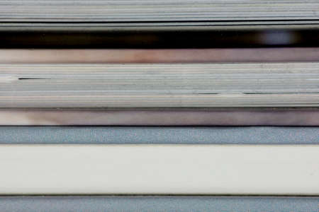 close-up of a the book edge of three colored photographic books Stok Fotoğraf
