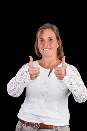 Attractive authentic european lady with white shirt showing thumbs up and positiveness