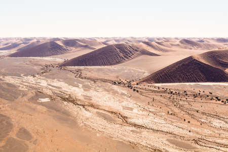 vlei: aerial view of the dunes of sossusvlei, part of the namib desert, located in namib naukluft park, namibia, africa