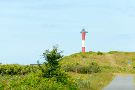 WANGEROOGE, GERMANY.  04th July 2017: View of the new lighthouse in the west on the island wangeroog, one of the seven east frisian ilands, is a beautiful wadden sea island located in the german sea.