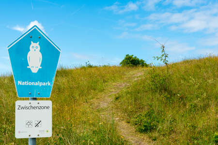 WANGEROOGE, GERMANY.  04th July 2017:  View of the sign of the national park on the island wangeroog, one of the seven east frisian ilands, is a beautiful wadden sea island located in the german sea. Editorial