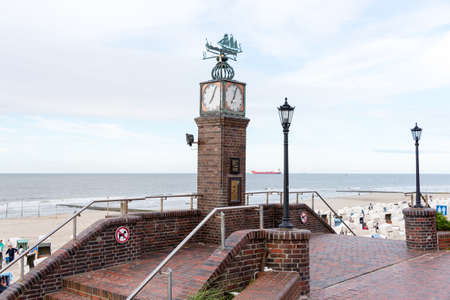 WANGEROOGE, GERMANY.  05th July 2017:  View of the famous tide watch on the seawall promenade of the island wangerooge, one of the seven german east frisian ilands, is a beautiful wadden sea island located in the german sea.