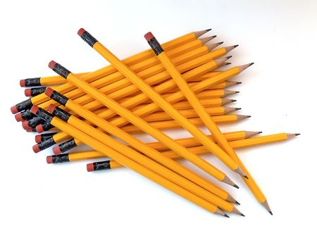 random pile of yellow pencils with erasers