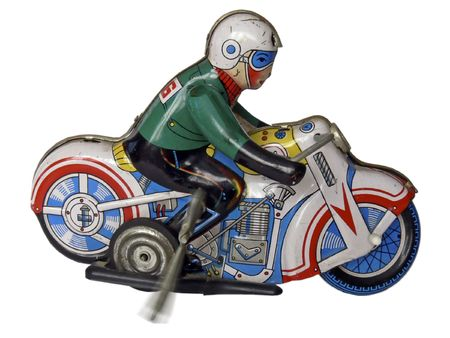 vintage tin toy, clockwork motorcycle and rider, on a white ground; key shown rotating