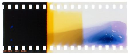 halide: colourful end of 35mm film splashed with chemicals Stock Photo