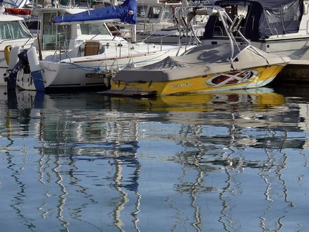 colorful reflections of boats in marina