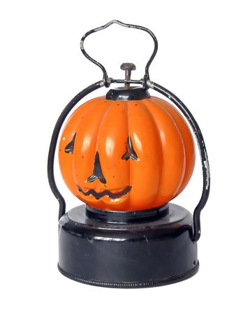 tinplate: vintage pumpkin lantern halloween electric torch, glass chimney with tinplate base, on a white ground