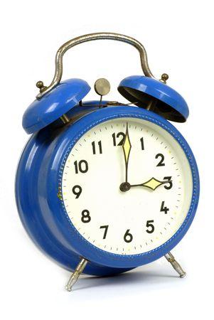 vintage blue clockwork alarm clock
