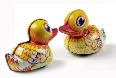 Duck Love: two tin toy ducks kissing