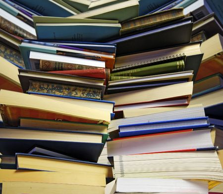 inundated: overwhelming piles of books Stock Photo