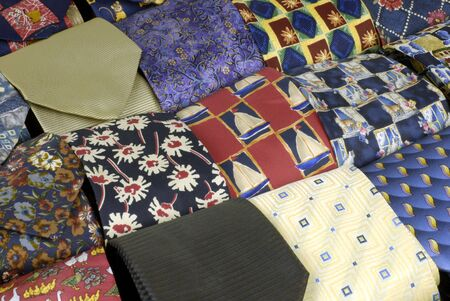 drawer of neatly-rolled neckties