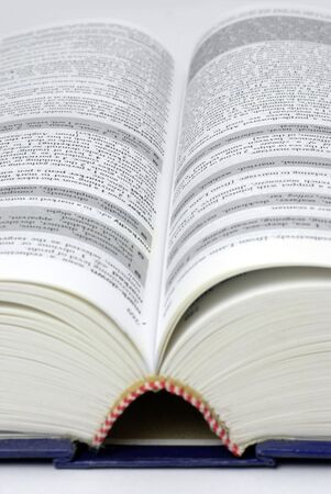 textreference book lying open; text mostly illegible due to differential focus
