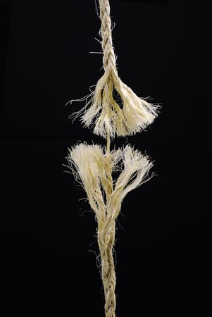 length of coarse rope fraying and about to part Stock Photo