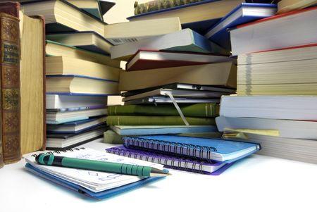 dissertation: overwhelming piles of books Stock Photo