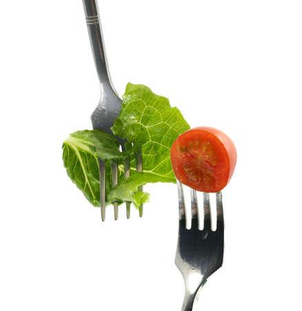 cherry-tomato and lettuce leaf impaled on forks