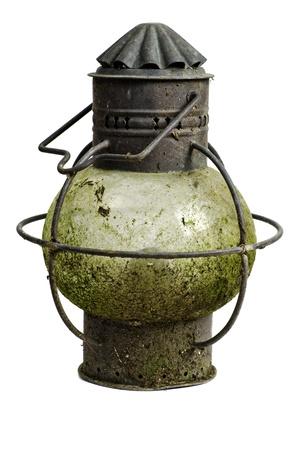 Antique ships copper anchor light; very corroded vintage kerosene lamp; isolated on white ground Stock Photo