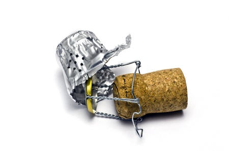 Champagne cork and foil cap; isolated on white ground