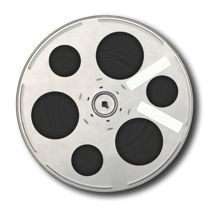 Movie film spool; isolated on white ground; two adhesive labels on spool, suitable for overwriting.
