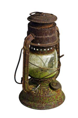 Hurricane lampstorm lantern; very corroded vintage kerosene lamp; isolated on white ground