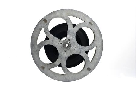 film reel: Movie film reel, partly filled; isolated on white ground Stock Photo
