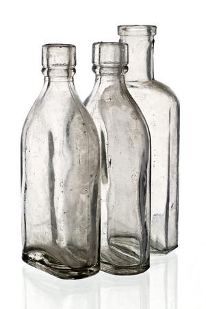 Vintage medicine bottles - isolated on white ground  photo