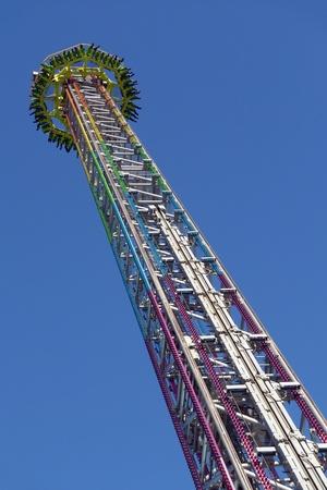 Amusement-park ride against brilliant blue sky