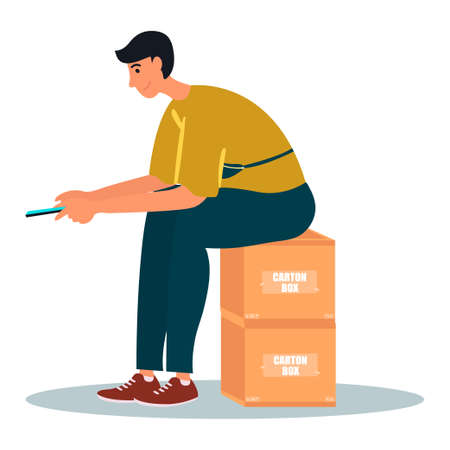 A Young man sits on carton boxes and checking own smartphone.Man is scrolling news feed.Vector illustration on white background in cartoon style. 向量圖像