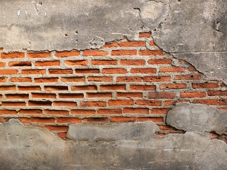 damaged house: old grunge brick wall with space for text, texture background