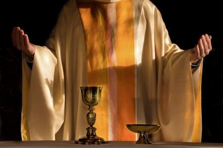 catholic priest in eucharistic prayer