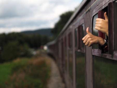 like english: Happy hands on the train