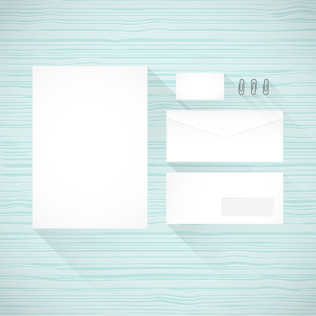 paperclips: Branding identity template. Turquoise wooden background. Letterhead, envelope, business card and paperclips. Flat design