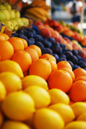 Oranges, lemons and other fruits at a market stand Stock Photo