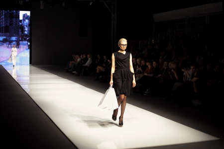 Female model at a fashion show on the runway
