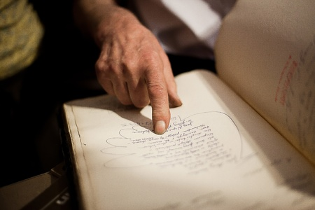 Photo of man in secondhand bookshop and his hands pointing old book Stock Photo