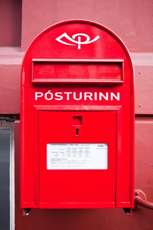Red post box on the wall