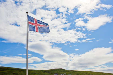 populated: Iceland flag waves in the sky Stock Photo