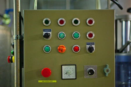 Control board with many buttons in a factory Stock Photo