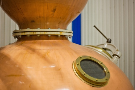 Copper vat with a window in the factory Stock Photo
