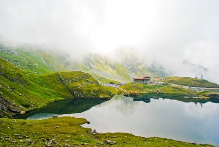 House by the lake in the mountains, Carpathians, Romania, Europe