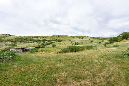 sheepfold: View on moldovan village green hills with sheepfold in summer time