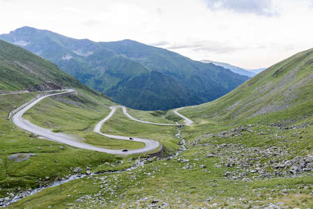 Photo of famous winding road in fagaras mountains at sunset, Romania.