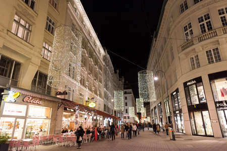 prada: VIENNA, AUSTRIA - NOVEMBER 13, 2015: City centre view at night, with Prada shops