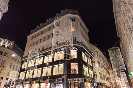 VIENNA, AUSTRIA - NOVEMBER 13, 2015: City centre view at night, with Louis Vuitton shops